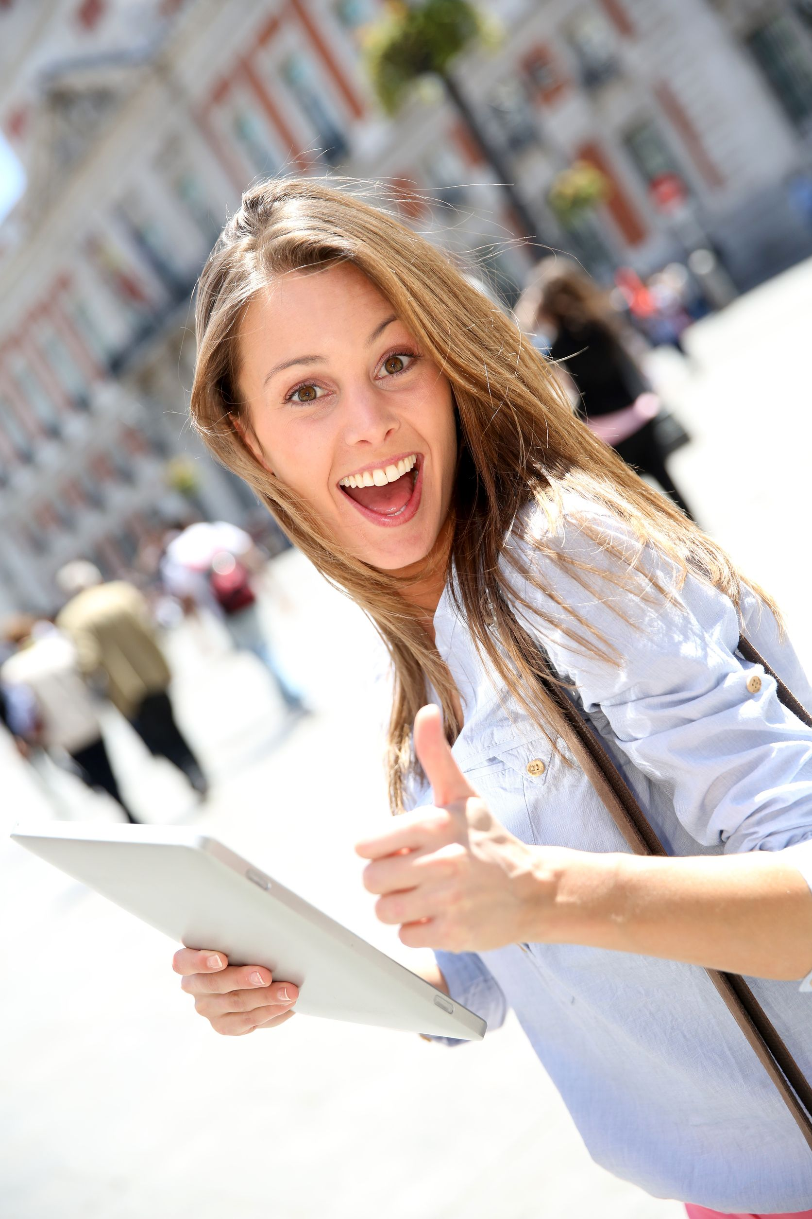 19821833 - cheerful girl with tablet showing thumb up